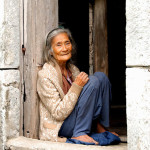 An 85-year old Ivatan woman sitting at her house door